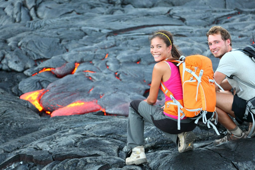 couple looking a lava in Hawaii